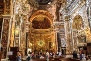 The interior of Santa Maria della Vittoria, facing the front of the church and the main altar
